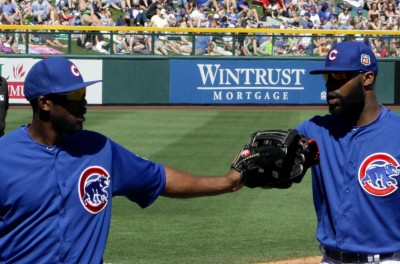 Dexter Fowler and Jason Heyward slap gloves between innings.