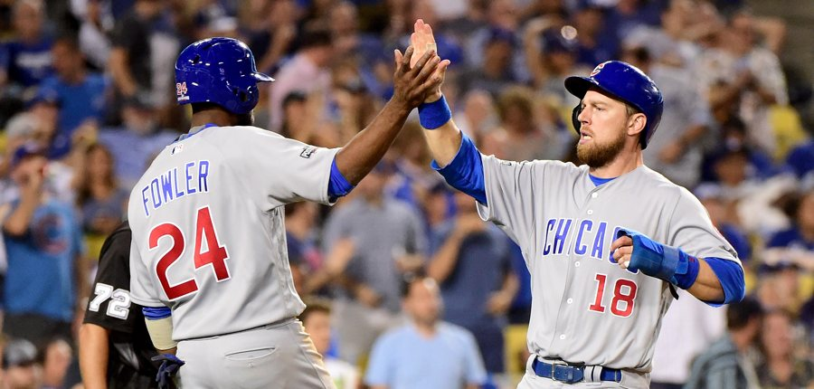Dexter-fowler-ben-zobrist-cubs-high-five-photo-by-harry-howgetty-images