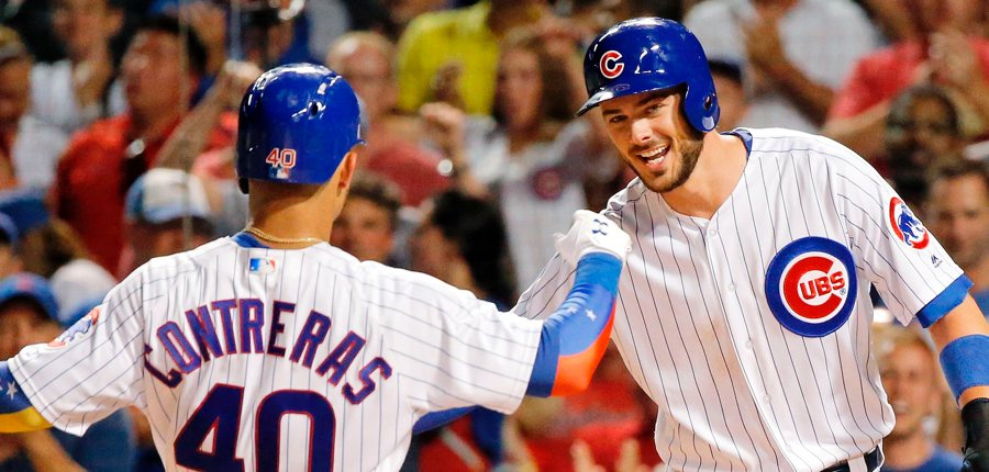 Kris-bryant-and-willson-contreras-high-five-cubs-photo-by-jon-durrgetty-images